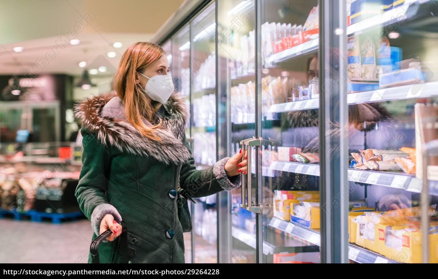 woman, at, supermarket, freezer, section, wearing - 29264228