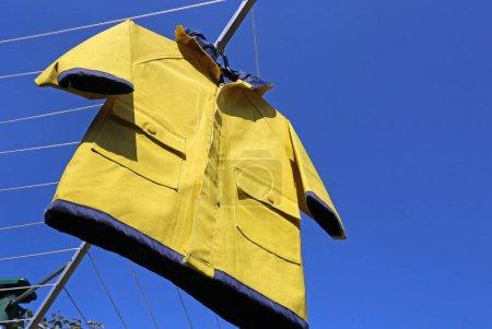 yellow, blue, clothing, protection, dress, hood - B359063062